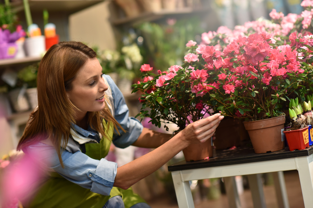 Woman working in a micro business flower shop
